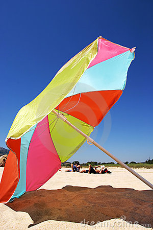 Free Large Colourful Umbrella On A Sunny Beach In Spain Royalty Free Stock Photos - 371648