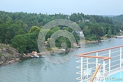 Large cruise ship deck near village