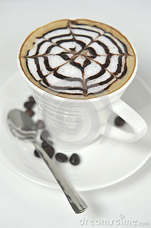 Large cup of coffee decorated with milk froth and chocolate draw