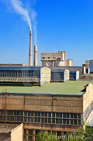Large factory with smoking chimneys.