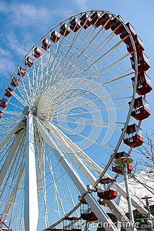 Large Ferris wheel in blue sky background
