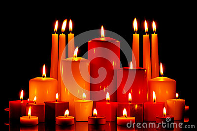 Large group of mixed candles burning