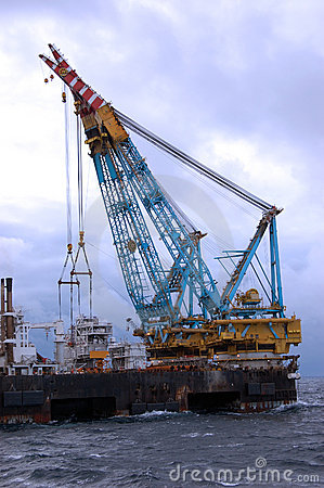 Large Heavy lift crane in operation in North Sea.
