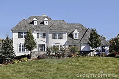 Large home with white siding