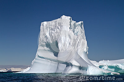 Large iceberg in Antarctic waters on a sunny summer
