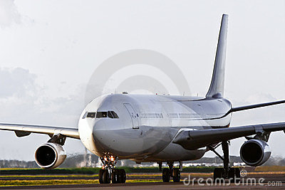 Large jet airliner taxiing on the runway