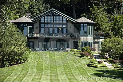 Large Luxury Mansion Estate Home and Grass Lawn