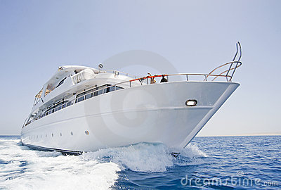 Large motor yacht under way at sea