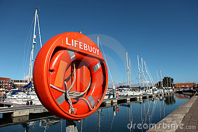 Large orange lifebuoy in Weymouth harbour
