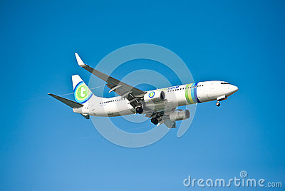 Large passenger plane flying in the blue sky Editorial Stock Photo
