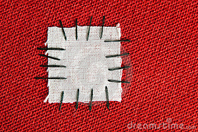 Large patch on red cloth