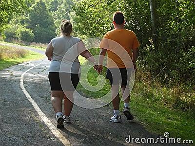 Large people walking on trail