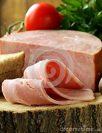 Large piece of ham on a cutting board