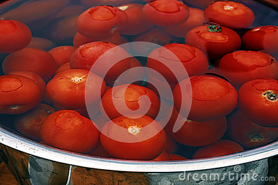 Large pot filled with water and washed tomatoes