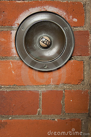 Large press button doorbell brick wall