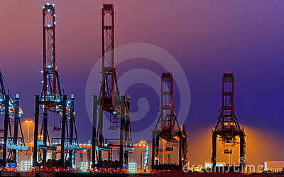 Large quay cranes at night