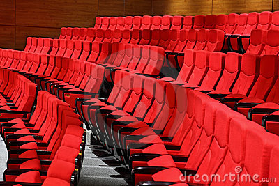 Large recliners stand rows in an empty hall Stock Photo