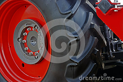 Large red wheel rim with rubber