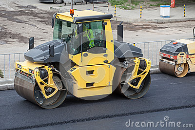 Large road-roller paving a road.