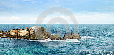Large rock in ocean