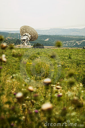 Large satellite dishes in countryside