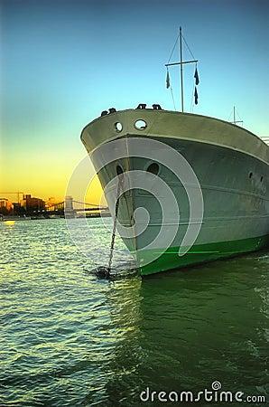 Large ship head on shot at sunset