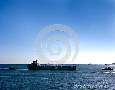 Large ship and tug boats