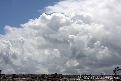 Large sky of clouds over lava field