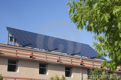 Large solar panel on building roof stock photos image for Does new roof affect appraisal