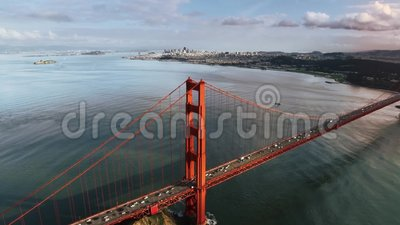 Large spectacular red steel Golden Gate bridge in San Francisco wild nature mountain hill aerial drone seascape skyline. Large spectacular red steel Golden Gate