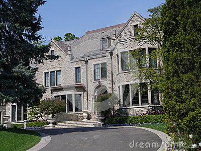 Large stone house with circular driveway Editorial Stock Photo