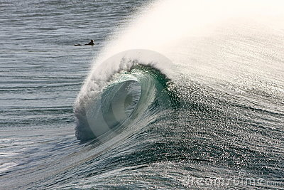 Large surf wave breaking with barrel view.