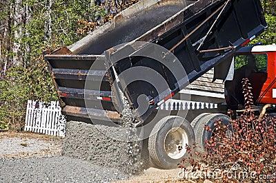 Large Truck Dumping Gravel