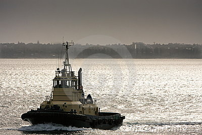 Large Tugboat at sea in late afternoon.
