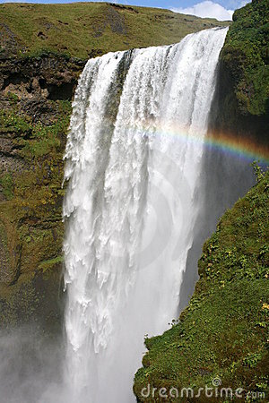 Large waterfall with small rainbow
