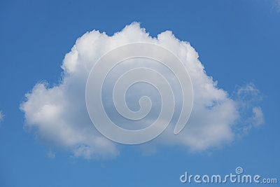 Large white cumulus cloud on the blue sky