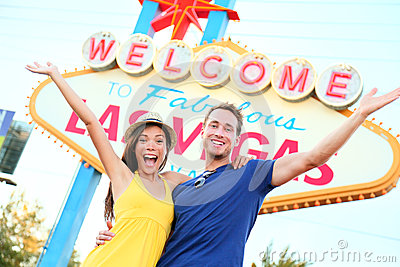 Las vegas people - couple happy cheering by sign