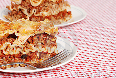 Lasagna on red and white tablecloth