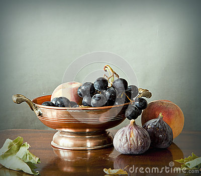 Late summer fruits in a copper bowl