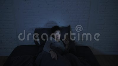 Lateral panning shot of young attractive hispanic woman upset in stress and insomnia lying anxious on bed trying to sleep stock video