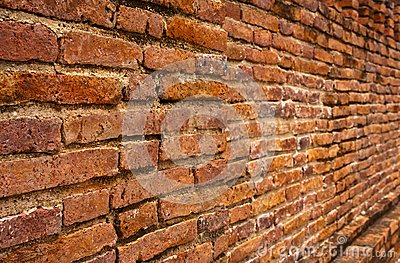Laterite brick wall tilted out close up
