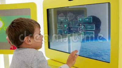 Latest methods of education, child play with touch panel, kid move their fingers along large touch screen, accelerated. Sofia, Bulgaria - 18 September 2016 stock video footage