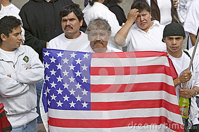 Latin American man holds US flag Editorial Stock Photo