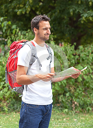 Latin backpacker with map