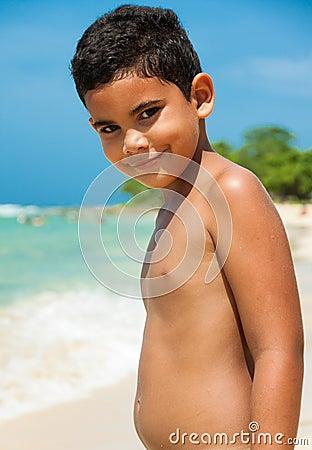 Latin boy on a tropical beach
