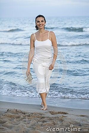 Latin female model on the beach