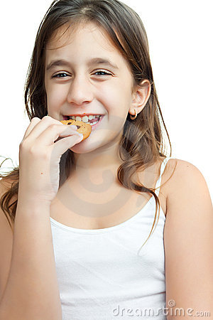 Latin girl eating a chocolate chips cookie
