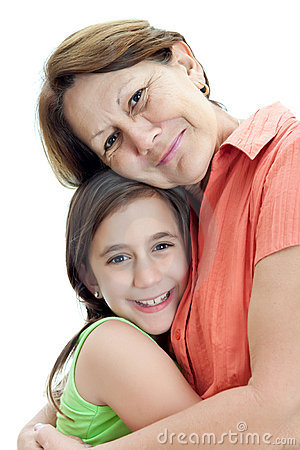 Latin girl hugging her grandmother isolated on whi