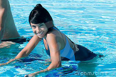 Latin girl water exercising