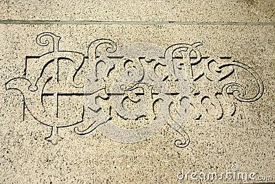 Latin phrase on a wall of the University in Leuven, Belgium